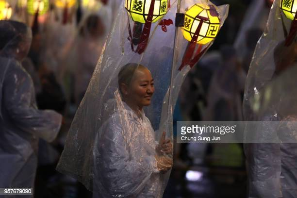 Buddhists carry colorful lanterns as they celebrate the forthcoming birthday of Buddha on May 12 2018 in Seoul South Korea Buddha was born...