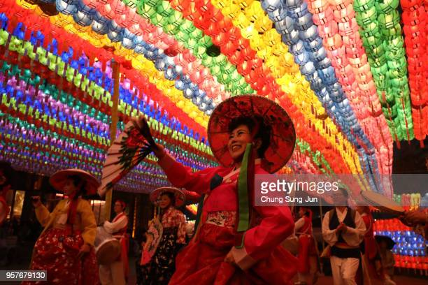 Buddhists gather under colorful lanterns as they celebrate the forthcoming birthday of Buddha at Jogye temple on May 12 2018 in Seoul South Korea...