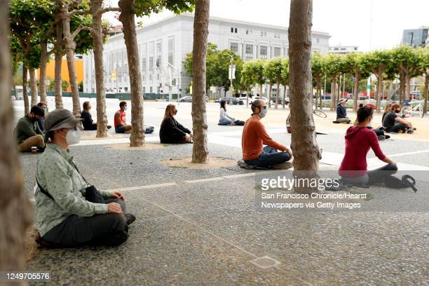 Buddhists meditate as they gather in Civic Center for Sit. Walk. Listen. Because Black Lives Matter event in San Francisco, Calif., on Sunday, June...