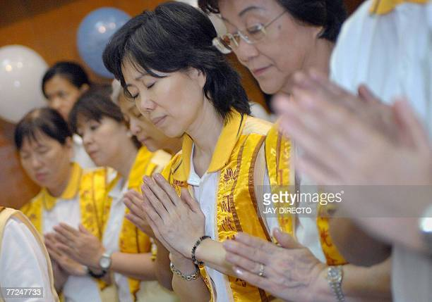 Buddhists meditate during a prayer rally at a Manila university 10 October 2007 as participants pray for peace and democracy in Myanmar Meanwhile...