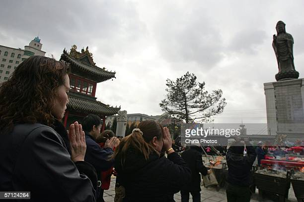 Buddhists pray in front of the statue of Goddess of Mercy to mark her birthday at Banruo Temple March 18 2006 in Changchun of Jilin Province China...