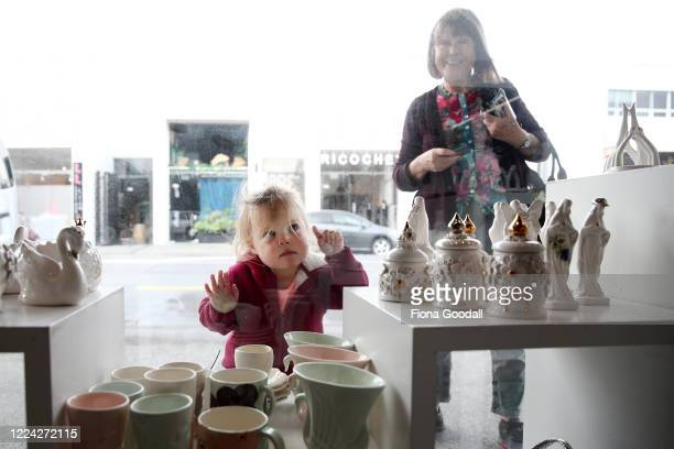 Budding art collector Emma DatryGirvan does some window shopping at The Poi Room in Ponsonby with her nana Judy Girvan as the staff prepare the store...