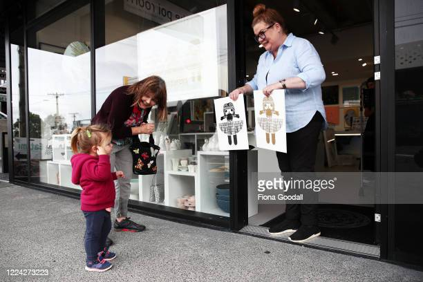 Budding art collector Emma DatryGirvan does some window shopping at The Poi Room in Ponsonby with her nana Judy Girvan as Megan Sadgrove helps...