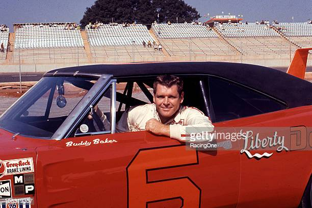 Buddy Baker poses with his Cotton Owensowned Dodge Charger Daytona at a NASCAR Cup race Baker capped off his 1970 season by winning the Southern 500...