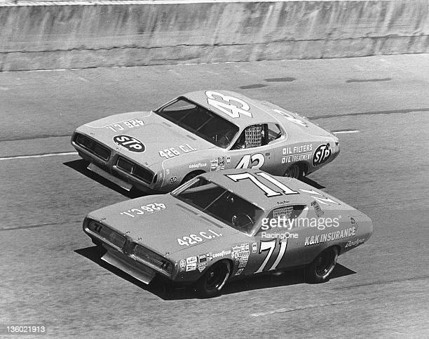 Buddy Baker races with fellow Dodge Charger driver Richard Petty on the high banks of Daytona International Speedway during a NASCAR Cup race