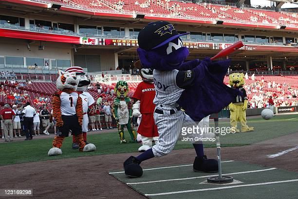 Buddy Bat of the Louisville Bats connects with a pitch during the annual Mascot Tee Ball game prior to the game between the Cincinnati Reds and...