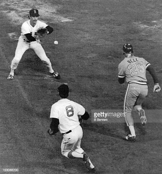 Buddy Bell of the Texas Rangers is caught in a run down with first baseman Carl Yastrzemski of the Boston Red Sox and Rick Burleson during their game...