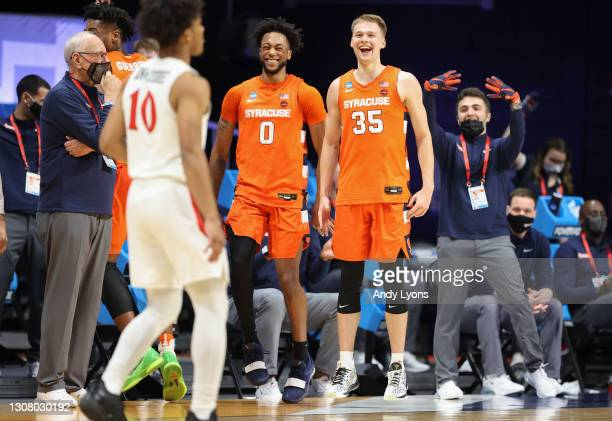 Buddy Boeheim and Alan Griffin of the Syracuse Orange react following their victory against the San Diego State Aztecs in the first round game of the...