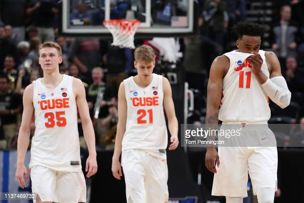 Buddy Boeheim Marek Dolezaj and Oshae Brissett of the Syracuse Orange walk off the court after losing 6978 to the Baylor Bears in the first round of...