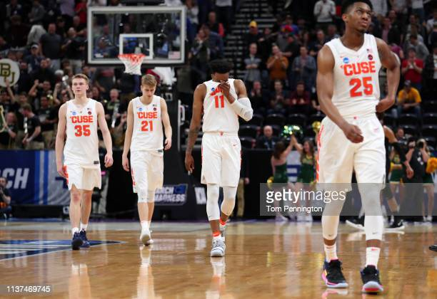 Buddy Boeheim Marek Dolezaj Oshae Brissett and Tyus Battle of the Syracuse Orange walk off the court after losing 6978 to the Baylor Bears in the...