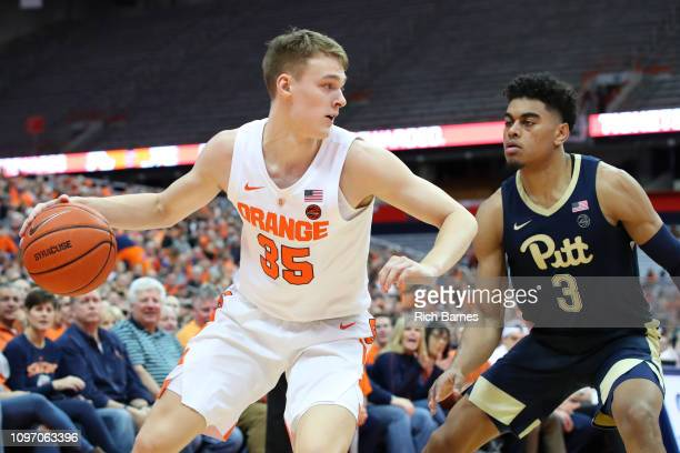 Buddy Boeheim of the Syracuse Orange controls the ball as Malik Ellison of the Pittsburgh Panthers defends during the second half at the Carrier Dome...