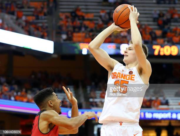 Buddy Boeheim of the Syracuse Orange shoots the ball over Tyler Kidd of the Eastern Washington Eagles during the second half at the Carrier Dome on...