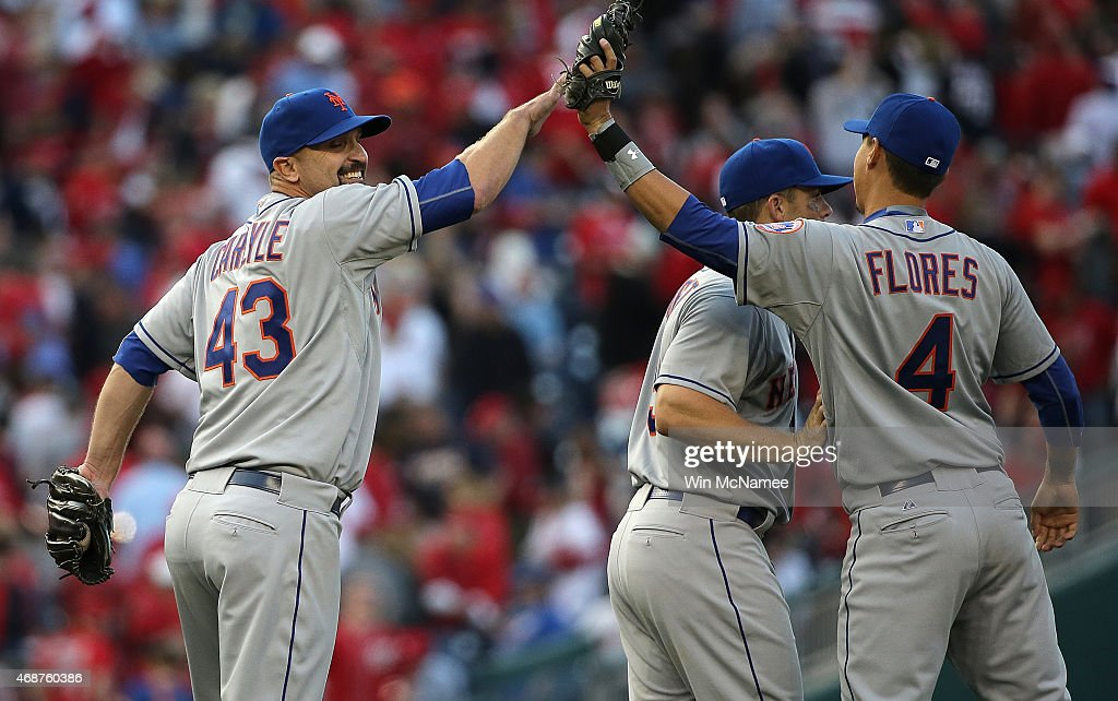 Buddy Carlyle #43 of the New York Mets celebrates with teammate Wilmer Flores #4 after notching a save against the Washington Nationals on Opening Day at Nationals Park on April 6, 2015 in Washington, DC. The Mets won the game 3-1.