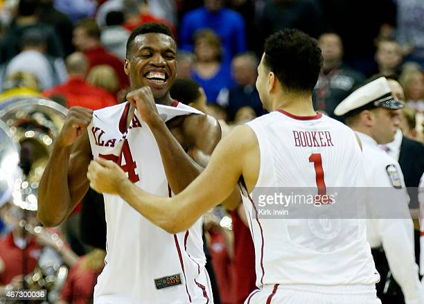 Buddy Hield and Frank Booker of the Oklahoma Sooners celebrate their 72 to 66 win over the Dayton Flyers during the third round of the 2015 NCAA...