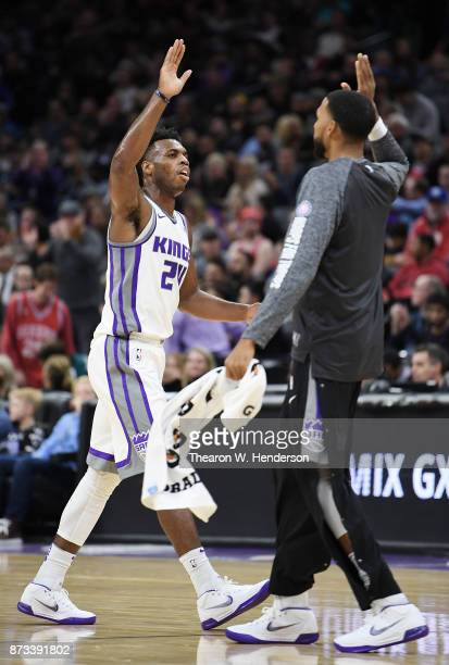Buddy Hield and Garrett Temple of the Sacramento Kings high five after a time out was called during an NBA basketball game against the Philadelphia...
