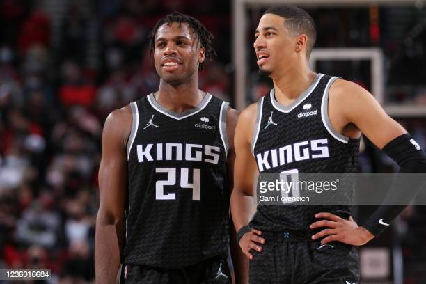 Buddy Hield and Tyrese Haliburton of the Sacramento Kings looks on during the game against the Portland Trail Blazers on October 20, 2021 at the Moda...