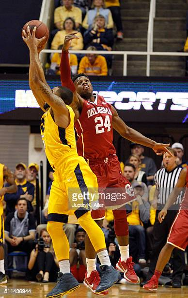 Buddy Hield of the Oklahoma Sooners and Jaysean Paige of the West Virginia Mountaineers battle for a ball during the game at the WVU Coliseum on...