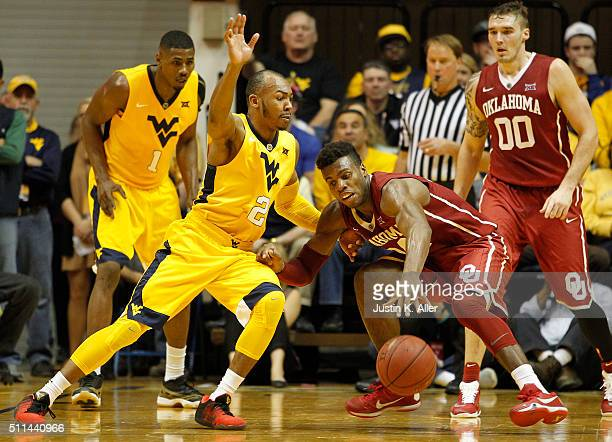 Buddy Hield of the Oklahoma Sooners and Jevon Carter of the West Virginia Mountaineers battle for a loose ball during the game at the WVU Coliseum on...