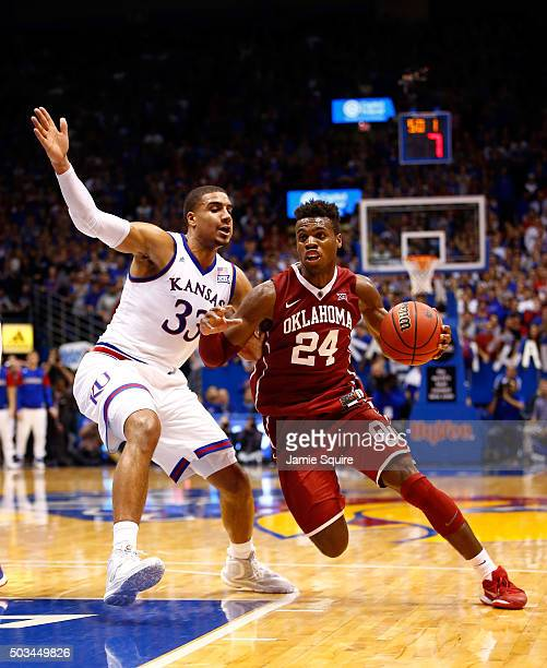 Buddy Hield of the Oklahoma Sooners drives with the ball as Landen Lucas of the Kansas Jayhawks defends during the game at Allen Fieldhouse on...