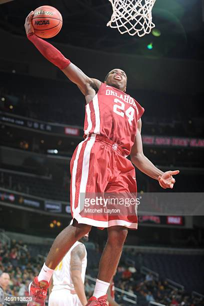 Buddy Hield of the Oklahoma Sooners goes for a jam during the BBT Classic college basketball game against the George Mason Patriots on December 8...