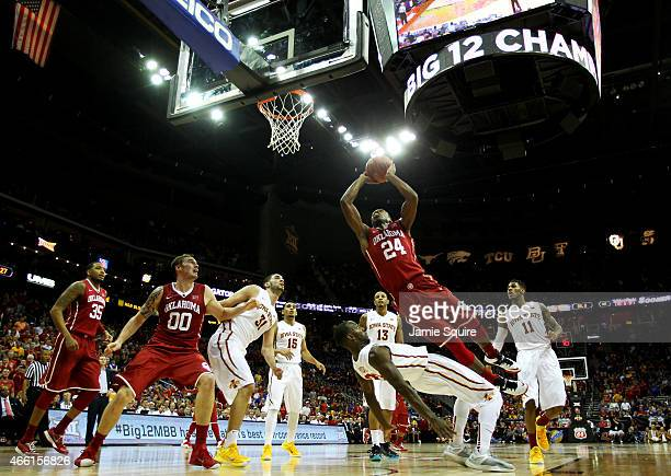 Buddy Hield of the Oklahoma Sooners goes up against Dustin Hogue of the Iowa State Cyclones in the first half during a semifinal game of the 2015 Big...
