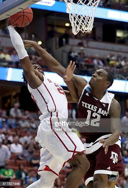 Buddy Hield of the Oklahoma Sooners goes up for a shot against Jalen Jones of the Texas AM Aggies in the first half in the 2016 NCAA Men's Basketball...