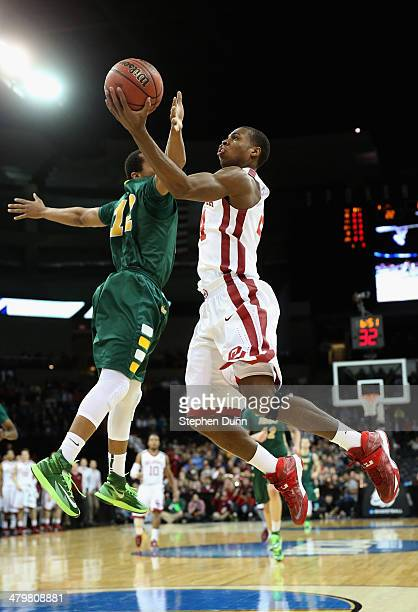 Buddy Hield of the Oklahoma Sooners goes up for a shot Lawrence Alexander of the North Dakota State Bison during the second round of the 2014 NCAA...