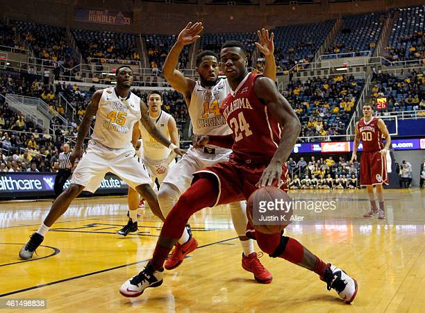 Buddy Hield of the Oklahoma Sooners handles the ball along the baseline against Gary Browne of the West Virginia Mountaineers during the game at the...