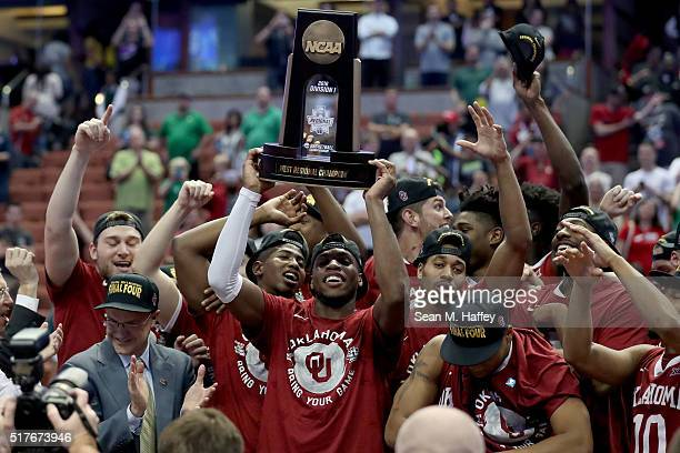 Buddy Hield of the Oklahoma Sooners holds up the West Regional trophy after the Sooners 80-68 victory against the Oregon Ducks in the NCAA Men's...