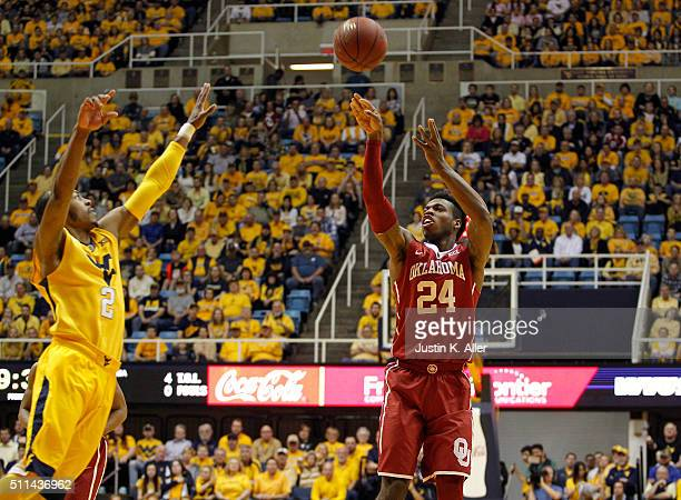 Buddy Hield of the Oklahoma Sooners pulls up for a shot during the game against Jevon Carter of the West Virginia Mountaineers at the WVU Coliseum on...