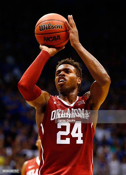 Buddy Hield of the Oklahoma Sooners shoots a free throw during the game against the Kansas Jayhawks at Allen Fieldhouse on January 4 2016 in Lawrence...