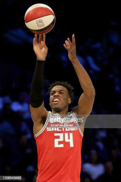 Buddy Hield of the Sacramento Kings attempts a shot in the 2020 NBA AllStar MTN DEW 3Point Contest during State Farm AllStar Saturday Night at the...