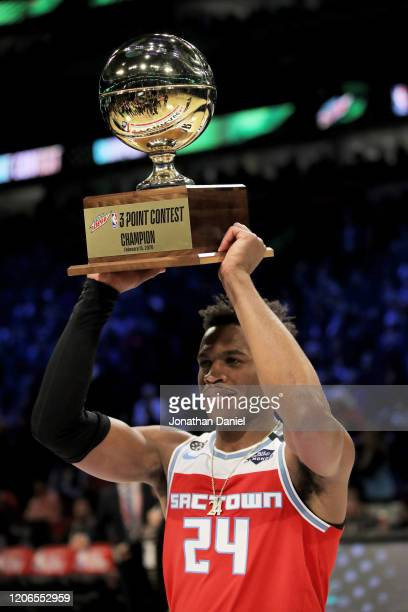 Buddy Hield of the Sacramento Kings celebrates with the trophy after winning the 2020 NBA All-Star - MTN DEW 3-Point Contest during State Farm...