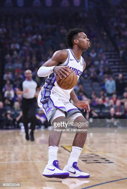 Buddy Hield of the Sacramento Kings dribbles the ball against the Charlotte Hornets during an NBA basketball game at Golden 1 Center on January 2...