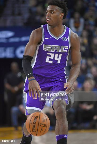 Buddy Hield of the Sacramento Kings dribbles the ball up court against the Golden State Warriors during their NBA basketball game at ORACLE Arena on...