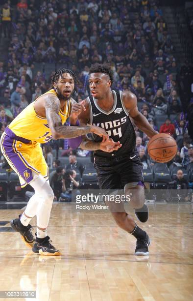 Buddy Hield of the Sacramento Kings drives against Brandon Ingram of the Los Angeles Lakers on November 10 2018 at Golden 1 Center in Sacramento...
