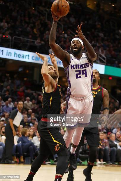 Buddy Hield of the Sacramento Kings gets a shot off next to Jose Calderon of the Cleveland Cavaliers during the first half at Quicken Loans Arena on...