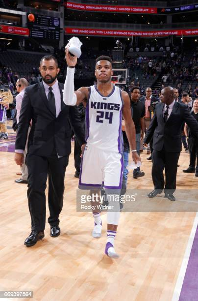 Buddy Hield of the Sacramento Kings gives away his shoes after the game against the Phoenix Suns on April 11 2017 at Golden 1 Center in Sacramento...