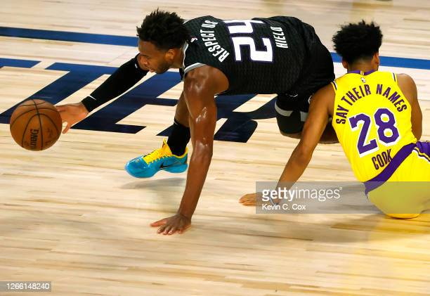 Buddy Hield of the Sacramento Kings grabs the ball after colliding with Quinn Cook of the Los Angeles Lakers during the second quarter at The Field...