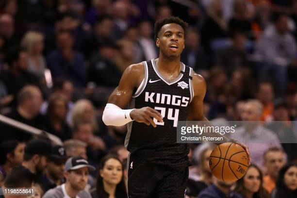 Buddy Hield of the Sacramento Kings handles the ball against the Phoenix Suns during the NBA game at Talking Stick Resort Arena on January 07, 2020...