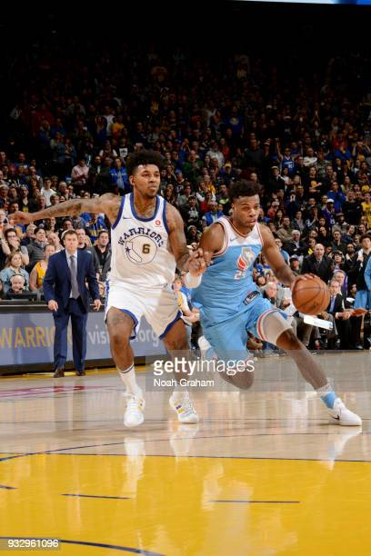 Buddy Hield of the Sacramento Kings handles the ball during the game against the Golden State Warriors on March 16 2018 at ORACLE Arena in Oakland...