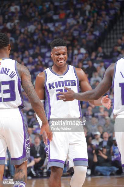 Buddy Hield of the Sacramento Kings high fives teammates during the game against the Phoenix Suns on April 11 2017 at Golden 1 Center in Sacramento...