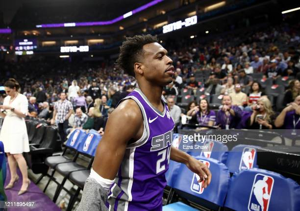 Buddy Hield of the Sacramento Kings leaves the court after their game against the New Orleans Pelicans was postponed due to the corona virus at...