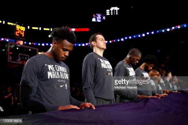 Buddy Hield of the Sacramento Kings observes the playing of the national anthem prior to the game against the Miami Heat during the first half at...