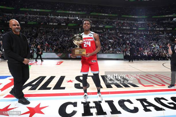 Buddy Hield of the Sacramento Kings raises the trophy after winning the 2020 NBA All-Star - MTN DEW 3-Point Contest on February 15, 2020 at the...