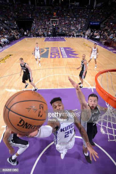 Buddy Hield of the Sacramento Kings shoots the ball against Joffrey Lauvergne of the San Antonio Spurs during the preseason game on October 2 2017 at...