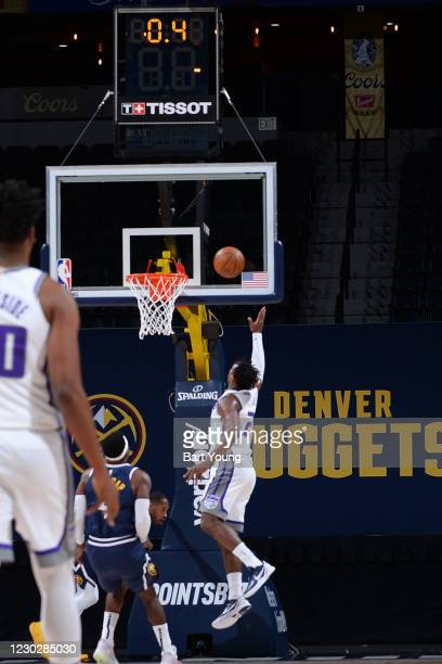 Buddy Hield of the Sacramento Kings shoots the game winning shot against the Denver Nuggets on December 23, 2020 at the Pepsi Center in Denver,...