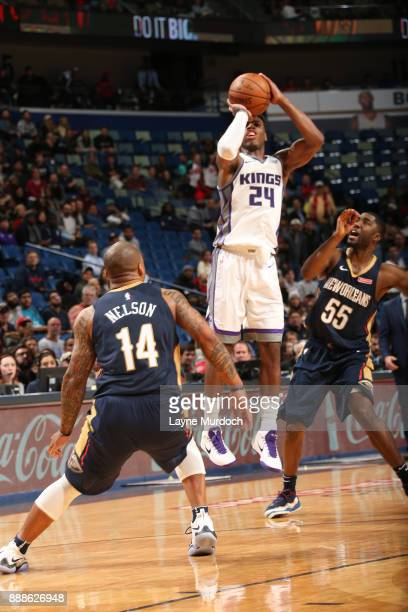 Buddy Hield of the Sacramento Kings shoots the threepoint shot to tie the game and defeat the New Orleans Pelicans on December 8 2017 at Smoothie...