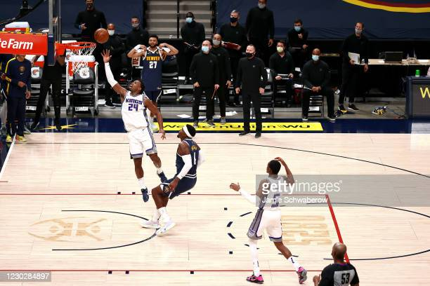 Buddy Hield of the Sacramento Kings tips in the game-winning shot against the Denver Nuggets at Ball Arena on December 23, 2020 in Denver, Colorado....