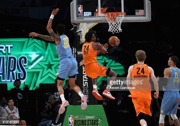 Buddy Hield of the World Team jumps to the basket past John Collins of the US Team during the 2018 Mountain Dew Kickstart Rising Stars Game at...